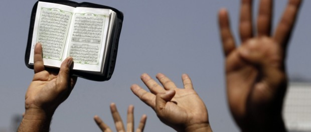 Supporters of the Muslim Brotherhood hold up a Koran in Cairo, August 23, 2013. (Amr Abdallah Dalsh / Courtesy Reuters)
