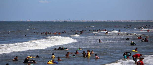 Egyptians swim in the Mediterranean sea at the beach in Dakahlia. Photograph: Mohamed El-Shahed/AFP/Getty Images