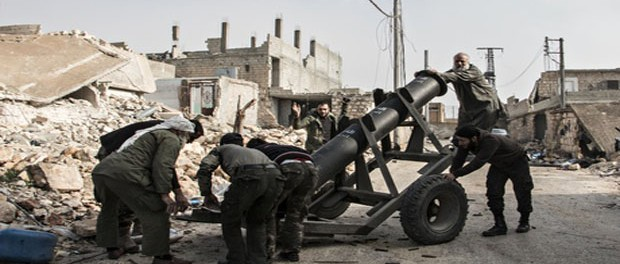 Syrian anti-regime rebels preparing a rocket launcher in Aleppo. Several Islamic military groups are defecting to Isis in the wake of US air strikes. Photograph: Karam Almasri/Demotix/Corbis