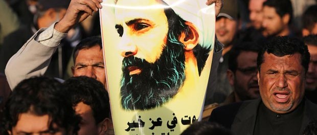 An Iraqi man holds a portrait of prominent Shiite Muslim cleric Nimr al-Nimr during a demonstration against his execution by Saudi authorities, on January 3, 2016, in the capital Baghdad. Iran and Iraq's top Shiite leaders condemned Saudi Arabia's execution of Nimr, warning ahead of protests that the killing was an injustice that could have serious consequences. AFP PHOTO