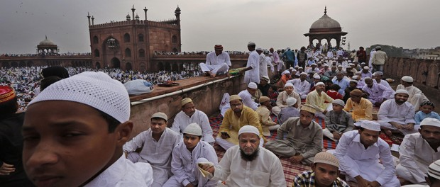 Indian Muslims wait to offer Eid al-Fitr prayers at Jama Masjid or Grand Mosque in New Delhi, India, Saturday, July 18, 2015. Millions of Muslims across the world are celebrating the Eid al-Fitr holiday, which marks the end of the month-long fast of Ramadan. (AP Photo/Manish Swarup)