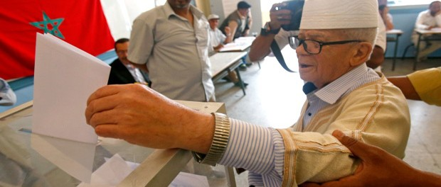 Moroccan Abdelaziz Ben Abdeslam, 87, casts his ballot at a polling station for the parliamentary elections, in Rabat, Morocco, Friday, Oct. 7